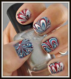 Red, white, and blue water marble nails---this is a link to the BEST marble nails tutorial that I have found!!!!!!!