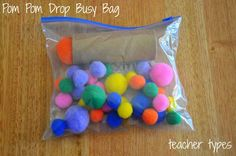 Pom Pom Ball Drop This one could not be simpler. Just grab a packet of pom poms from a craft or dollar shop and pair with a cardboard tube. You'll be amazed at how long a one year old can be entertained posting the pom poms down the tube over and over again. Activities For 1 Year Olds, Road Trip Activities, Infant Activities, Airplane Activities, Toddler Car Ride Activities, Time Activities, Toddler Play, Toddler Busy Bags, Toddler Games