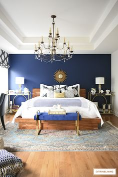 A GORGEOUS BOHO GLAM BEDROOM MAKEOVER! This gorgeous bedroom makeover went from dark and drab to bright and sophisticated with a boho glam edge that will make you want to create this look yourself! Dark Blue Bedrooms, Blue Master Bedroom, Blue Bedroom Walls, Blue Accent Walls, Blue Bedroom Decor, Glam Bedroom, Blue Rooms, Master Bedroom Design, Home Bedroom