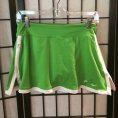 Green workout skirt Green workout/tennis/golf skirt with spandex shorts underneath, worn once. Nike dri-fit Nike Skirts