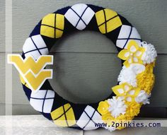 """West Virginia Mountaineers Wreath - 14"""" Wreath, Blue, Yellow and White, WVU. $50.00, via Etsy."""