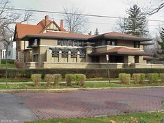 """This is Meyer May house in Grand Rapids, the first Frank Lloyd Wright house built in Michigan. This was built in 1908-1909, and stands in stark contrast to the other houses in the neighborhood. Yet it also fits in fairly well, a testament to Wright's ability to radically change architecture while still adhering to many of the architectural fundamentals of the early 20th century. I can't say the same for the sleek and boxy designs from the """"Modernist"""" architects who came to America in the…"""