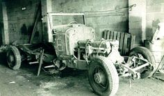 I have no idea what make of car this old girl is. She was found with a tree growing through her covered in ivy whilst bridging a hole in a wall/hedge on a local farm, this was taken in TERRY's shot blasting yard circa 1980. I believe a well known business man (Keith Schelleninburg  was intending to restore it. I do hope so!