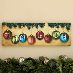 "A Personal Creations Exclusive! Accent your holiday home with our distinctive Ornament Canvas. A lovely finishing touch for your mantel, it features retro-style ball ornaments in dazzling jewel tones. We personalize it with any name, up to 12 characters. Canvas is stretched over a solid wood frame and measures 6"" H x 18"" W."