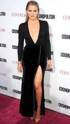 Khloe Kardashian in a plunging black dress with thigh-high slit