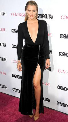 Khloe Kardashian in a plunging black dress with thigh-high slit