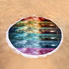 "Rainbow Galaxy Round Beach Towel by Johari Smith.  The beach towel is 60"" in diameter and made from 100% polyester fabric."