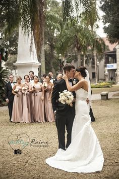 Love that the wedding party is in the background :)