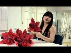 How to make 3D origami flowers out of construction paper. For pictures on how we put them on display, click here: http://chloedao.com/3d-origami-flower-demo-for-the-lot-8-summer-window/