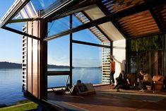 Garage is a residential cabin converted by Seattle-based design studio Graypants from a post World War II garage in Vashon island. The building is a Transformer Un Garage, Design Studio, House Design, Coffee Table Inspiration, House Seasons, Off Grid House, Lakeside Cabin, Vashon Island, Tiny House