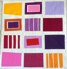 Beautiful quilt!  I like all of it: the solids, the stripes, and the wonderful quilting.  Gotta try it!