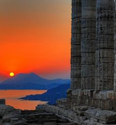 theunauthorizedhistory:duffel:      Sunset at Temple of Poseidon, which is located two hours south of Athens, Greece at Cape Sunion.  Photo by Bobesh.      (via duffelup)
