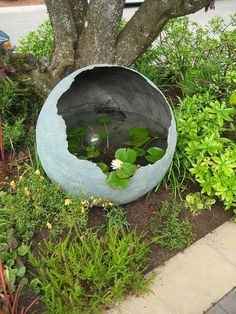 Little and Lewis water feature in Marie's Garden entry--- This is amazing.This is one AWESOME concrete sphere used as a water garden.Spray the inside of your concrete sphere with Rust-Oleum LeakSeal and fill with water for a pretty water feature. Concrete Pots, Concrete Crafts, Concrete Projects, Concrete Garden Ornaments, Garden Crafts, Garden Projects, Diy Projects, Diy Crafts, Yard Art