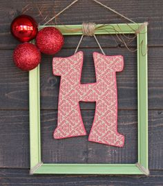 monogrammed picture frame with christmas ornaments. Too cute!