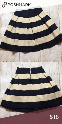 Black and cream stripped skirt Heavy weight. Small scalloped detailing in color blocks. Exposed back zipper. Pleated.  Runs small, presumably juniors Skirts Mini