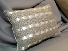Beautiful burlap pillows with satin ribbon makes beautiful decorative pieces for any room! via The Country Chic Cottage