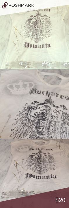 Bucharest Romania Sequin White T-Shirt 100% Cotton.  Realitee T-Shirt Eagle Bucharest Romania Sequin Open Back.  Excellent Used Condition - never worn.  However a little makeup on inside collar of shirt - I'm sure it will wash off in Laundry. Sz. Large.  Sleeveless.  Sequin trim bottom.  Super Soft. Realitee Tops Tees - Short Sleeve