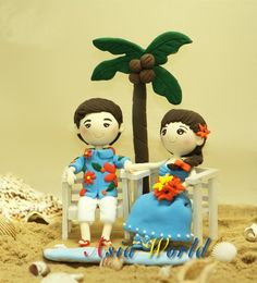 Beach wedding cake topper, Wedding clay doll in beach theme, rings holder, engagement, bridal shower, anniversary or perfect gift for couple in wedding, impressive gift for any special day or a great keepsake for keep forever. Beach wedding clay cake topper : guy in floral shirt and short (Hawaiian style) and his wife in blue dress and hold the flower which same color with his shirt. They are sitting and enjoying happiness beside the coconut tree, blue ocean and white sand. All in blue…