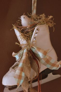 Love this sweet bird's nest tucked in the skate and tied with gingham...cool way to tie winter and spring decor together...would look cute if it was sunny or snowing!