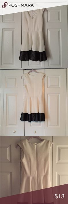 Skater Dress Gently used skater dress cute for date night or a girls night on the town. It has a black faux leather trim on the bottom to give it some edge! Charlotte Russe Dresses