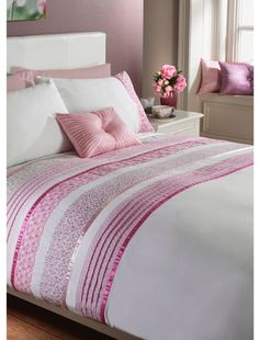 Dusky pink is a good choice for those who don't want to be overpowered by a pink bedroom colour scheme. Keep it fresh and clean with lots of white and keep pattern to a minimum for smart, fresh feel. Patchwork Duvet Set in rose from  Matalan.