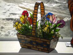 Flower Basket-AmberLyn's - These flowers will never die! the basket has many pieces and strong line so you can actually pick it up by the handle without it falling apart from the weight of the the bottom!
