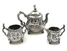 Frederick Elkington English silver three piece figural tea set