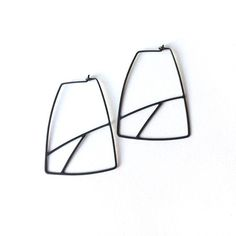 Thin, delicate, geometric hoops in oxidized sterling silver. Approximately 1 3/4 inches in length. Available in oxidized sterling, bright sterling ...