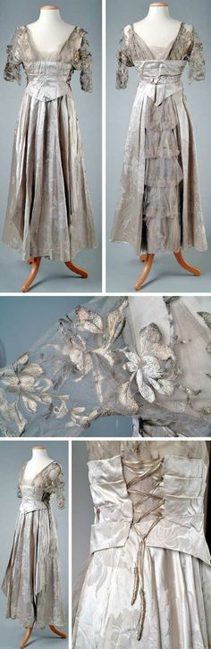 Evening gown, Withey (or Witey), Detroit, 1914. Pearl gray silk brocade in an orchid pattern. Trimmed with metallic embroidered silk net and has an 18th century pannier effect on the hip. Detroit Historical Museum