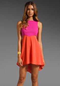 DONNA MIZANI Diamond Flounce Dress in Fuchsia/Coral at Revolve Clothing - Free Shipping!