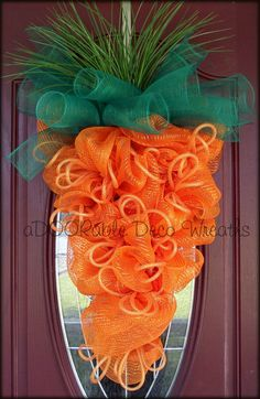 Carrot Easter Wreath by aDOORableDecoWreaths on Etsy I like this one better than any others I've seen