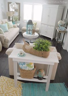 Fresh & Fun Living Room Refresh: diy reclaimed pallet wood table painted makeover. Casual beach vibe with coastal decor in neutral aqua white and yellow. foxhollowcottage.com #coastal #homedeocorating #homegoodshappy #CoastalDecorGrey