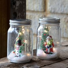 "Set the season with our Snowman and Santa Lighted Filled Canning Jar. This rustic up cycled glass jar can be used as a lantern for your home or garden. This set of 2 canning jar features adorable depictions of Santa and a snowman. Mason jars are a quintessential part of country Christmas decor, and these festive ornaments don't disappoint! The old-timey winter scenes have a nostalgic feel. Perfect for Christmas and through the Winter season. Measurement: 4"" x 4"" x 6.5"", Made of glass… Christmas Jam, Christmas Mason Jars, Christmas Scenes, Outdoor Christmas, White Christmas, Christmas Ornaments Handmade, Christmas House Lights, Christmas Displays, Christmas Lanterns"
