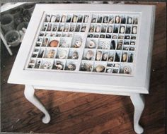 printer's case with seashells... made into a table