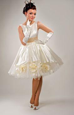 Stunning little Ivory satin swing dress. Love it!                                                                                                                                                     More
