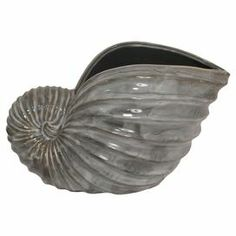 """Showcasing a charming seashell silhouette, this ceramic vase brings a coastal touch to your hall console table or living room curio cabinet.  Product: VaseConstruction Material: CeramicColor: GreyDimensions: 9.5"""" H x 15"""" W x 7"""" D"""