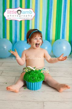 2 Year Old Cake Smash | Blue and green giant cupcake.  Red headed little girl.  Gatineau baby cake smash photographers.  Little Lamb Photography.