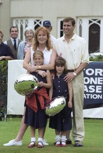 Duchess of York and HRH Prince Andrew with their daughters HRH Princess Beatrice (left) and HRH Princess Eugenie attend a golf event in aid of Motor Neaurone Disease, Wentworth golf club, Britain August 1997