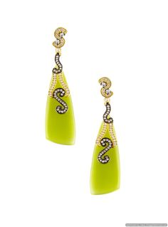 These pieces radiates warmth and opulence and is a perfect ornament to counter balance the smart ivory dress. http://www.mirraw.com/designers/jahnvi/designs/peridot-magic-danglers-drop