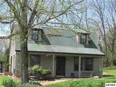 Cute cottage - 2 beds, 2 baths $118k in Strawberry Plains,TN  No garage but looks like there's enough room for one.