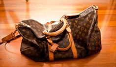 Louis Vuitton duffle bag..I have one, my husband ripped the strap holder on a trip...ugh need a repair...my treasure!