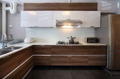 ADMIRA Walnut lyon laminate used in this beautiful white contemporary kitchen.