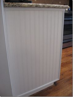 beadboard wallpaper...who would of thunk? I think I might use this for my dreaded soffits above my kitchen cabinets.