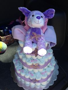 Purple and lavender diaper cake for baby shower.