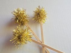A dozen Gold tinsel toppers for the holidays or just a fun sparkle party. Use them to decorate your cupcakes, party treats or use them as drink