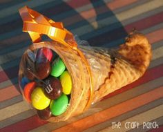 Thanksgiving craft for kids or could give for a gift to thank someone. Dip tip of cone in water for 20 seconds, microwave for 20 seconds. Then use a clean pencil to mold tip, hold in place for 20 seconds, or until set.