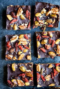 No bake superfood brownie energy bars packed with pistachios, pecans, walnuts, chia seeds, coconut and dried fruit! Topped with dark chocolate and sea salt. The perfect nutritious healthy dessert.