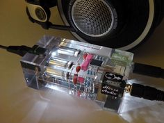 A hand built headphone amp encased in clear resin. BEAUTIFUL
