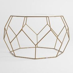 Bring a modern edge to your living area with our faceted coffee table. It features a dimensional geometric frame and an octagon-shaped glass surface that keeps visual space open for a clean look.
