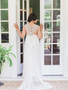 Anna Campbell bride. Bridal style. Estate wedding. Back of gown shot.  Jeweled wedding dress. Blush and navy wedding. Vow Renewal ideas. Gown | Anna Campbell Floral Design + Event Stylist | A Styled Fete Venue | Belmont Hall Stacy Hart Photography
